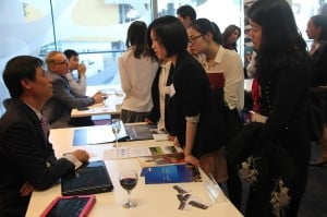 Professor Charles Qin talking to students at the Translating and Interpreting Expo at Monash University